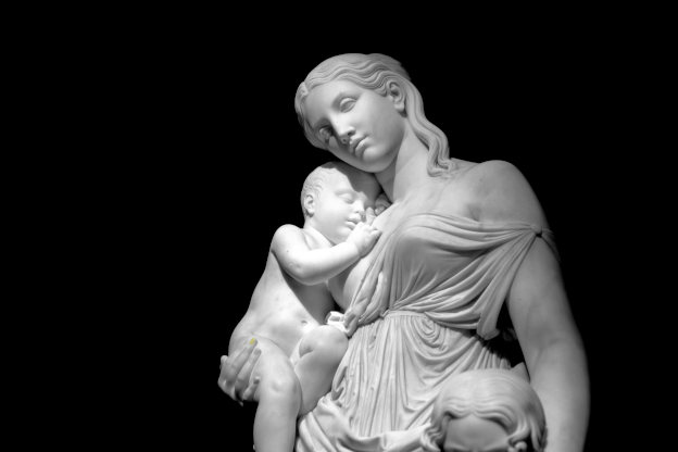statue of mother holding baby